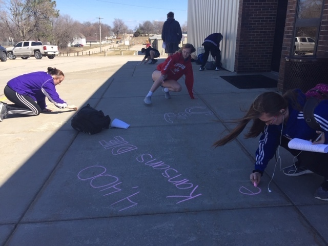 "Students using sidewalk chalk for anti-smoking ""kick butts"" day"