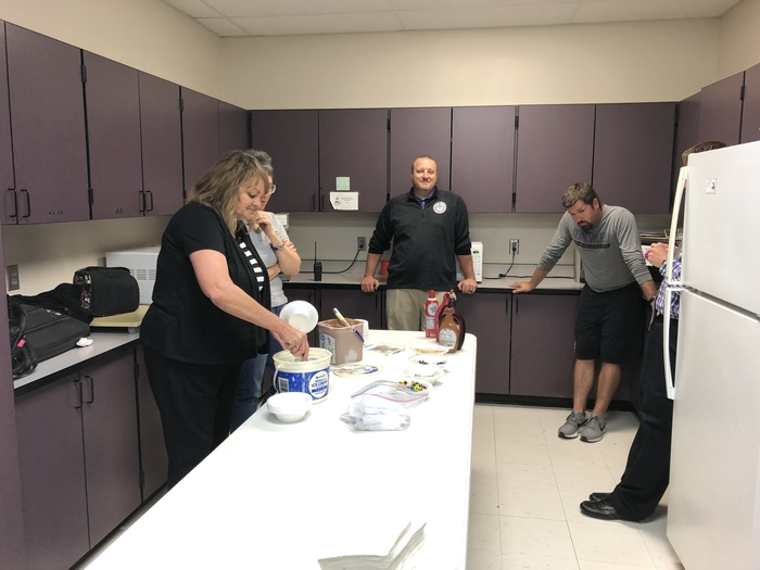 School board members serving ice cream