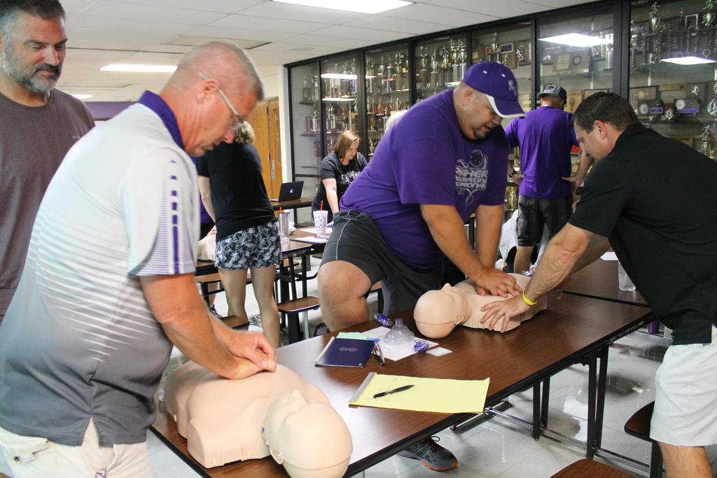 Higley and McClane practice on the CPR dummies