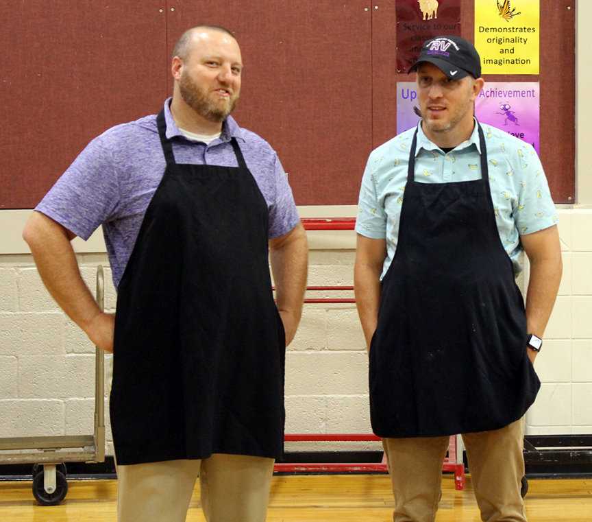 Aaric and Noah in aprons