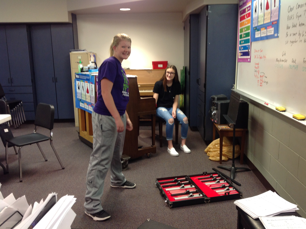 Assisting Mrs. Kahle in vocal classes.