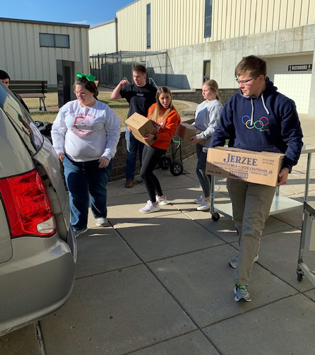 NHS members loading food in car