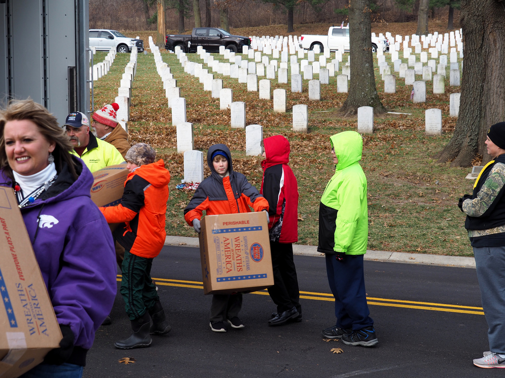 students carrying boxes of wreaths