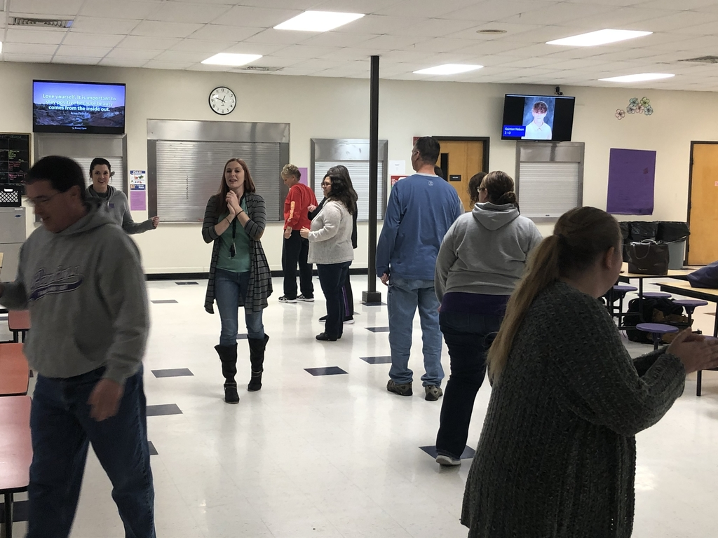 Middle school staff playing a opposite game