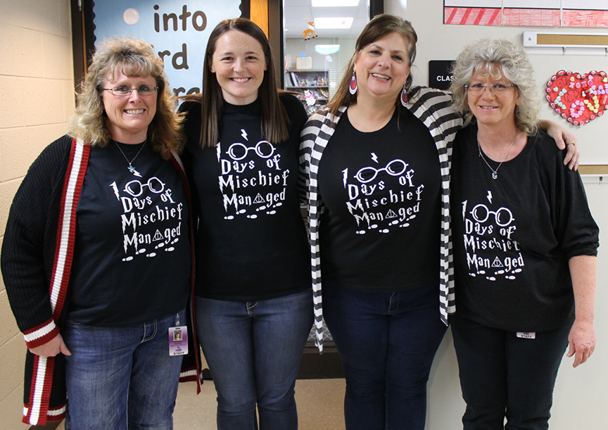 4 teachers in Mischief Managed t-shirts