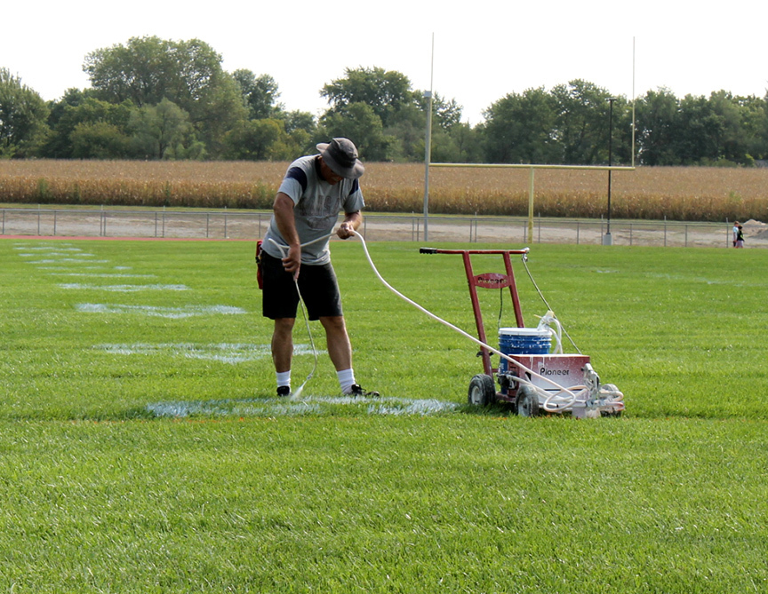Ferrell painting lines on field